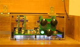 Photo of TRANSPARENT 3D Six preamplifier, used inside a wooden cabinet