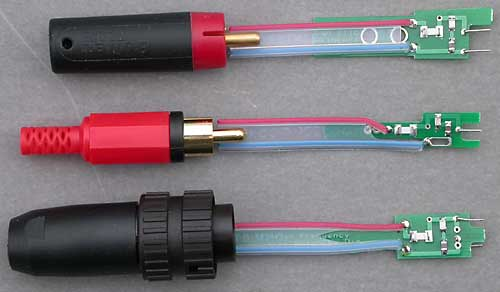 DNM High Frequency Termination Networks for DNM interconnect cable, with their matching plugs on the left